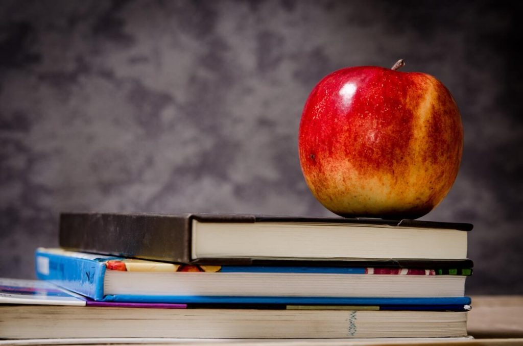 close-up-of-apple-on-top-of-books-256520(1)