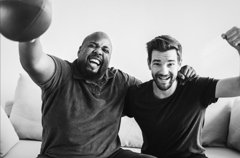 2 guys watching sports