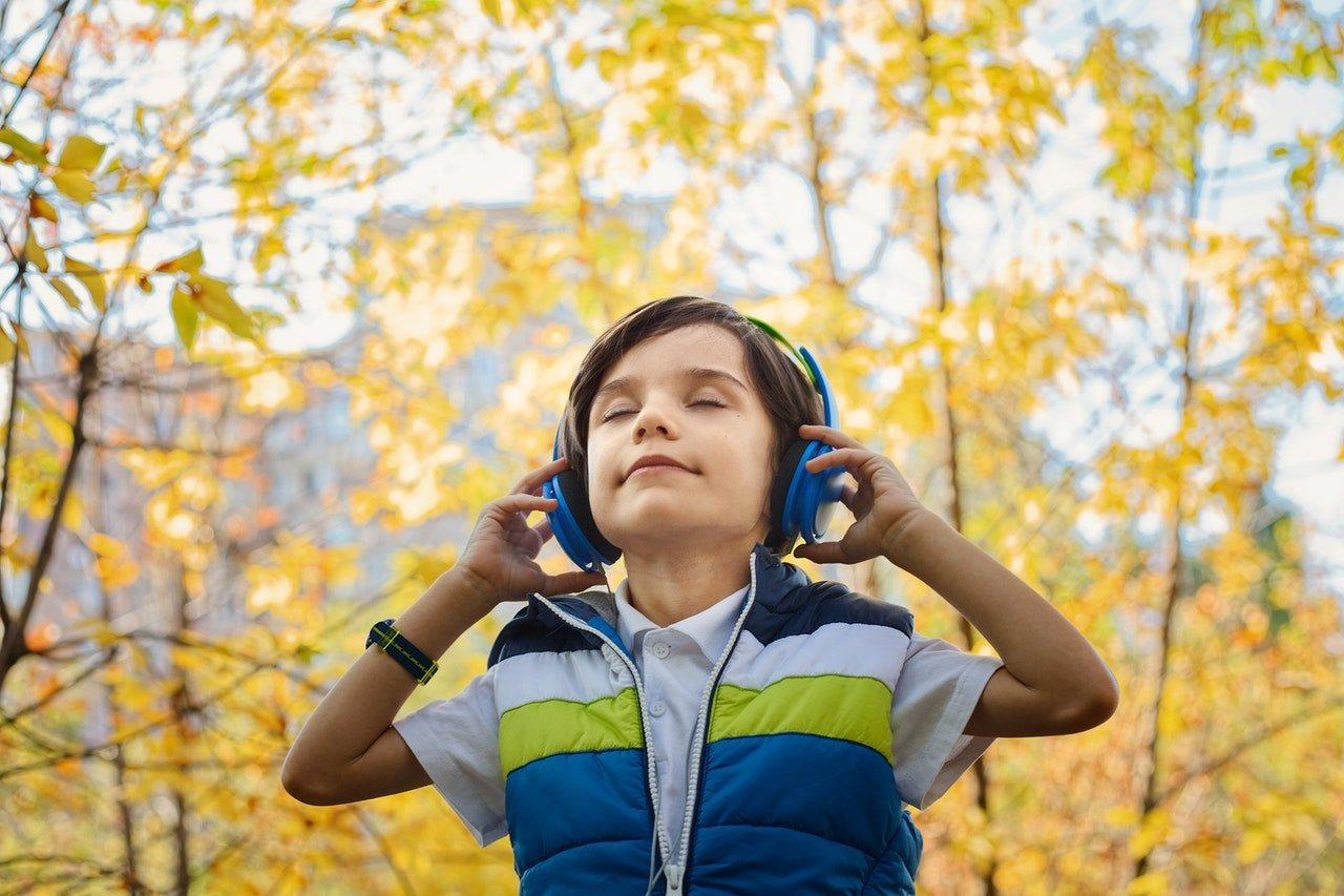 photo-of-a-boy-listening-in-headphones-1490844