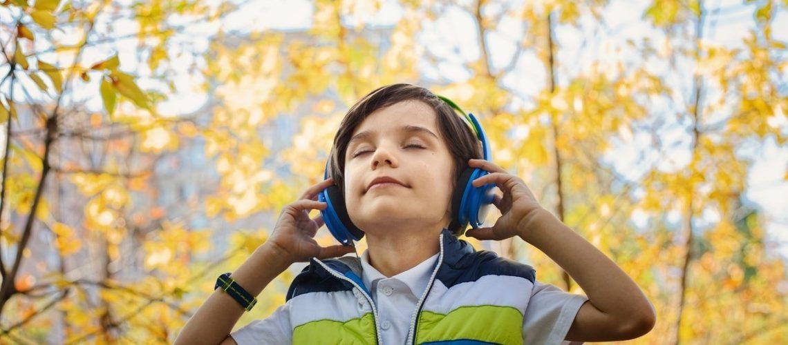 photo-of-a-boy-listening-in-headphones-1490844