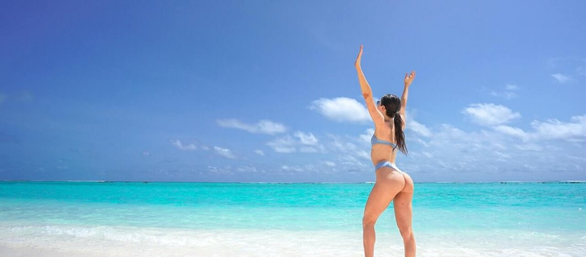 photo-of-woman-in-bikini-at-the-beach-posing-with-her-hands-3155674(1)