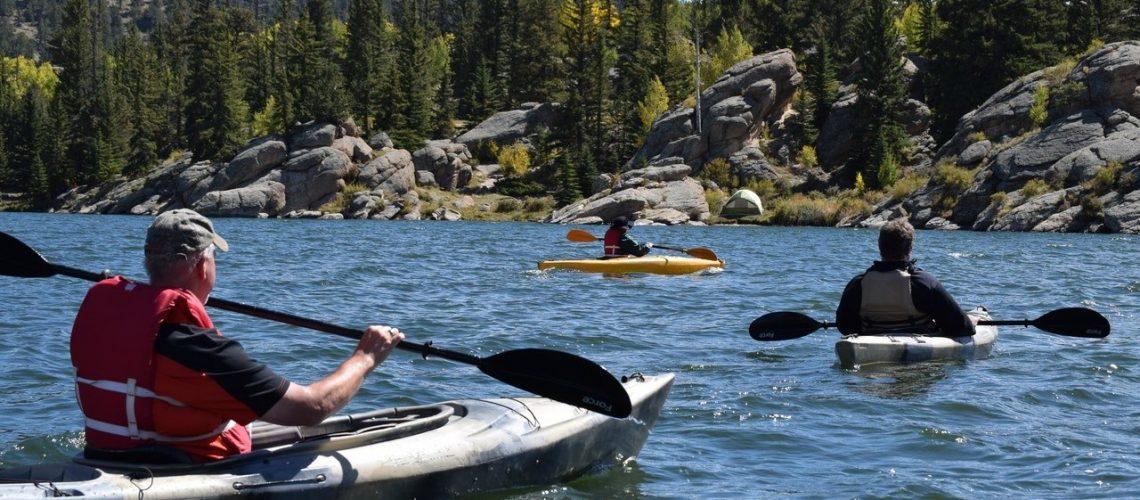 three-men-riding-kayaks-on-body-of-water-1497587.jpg