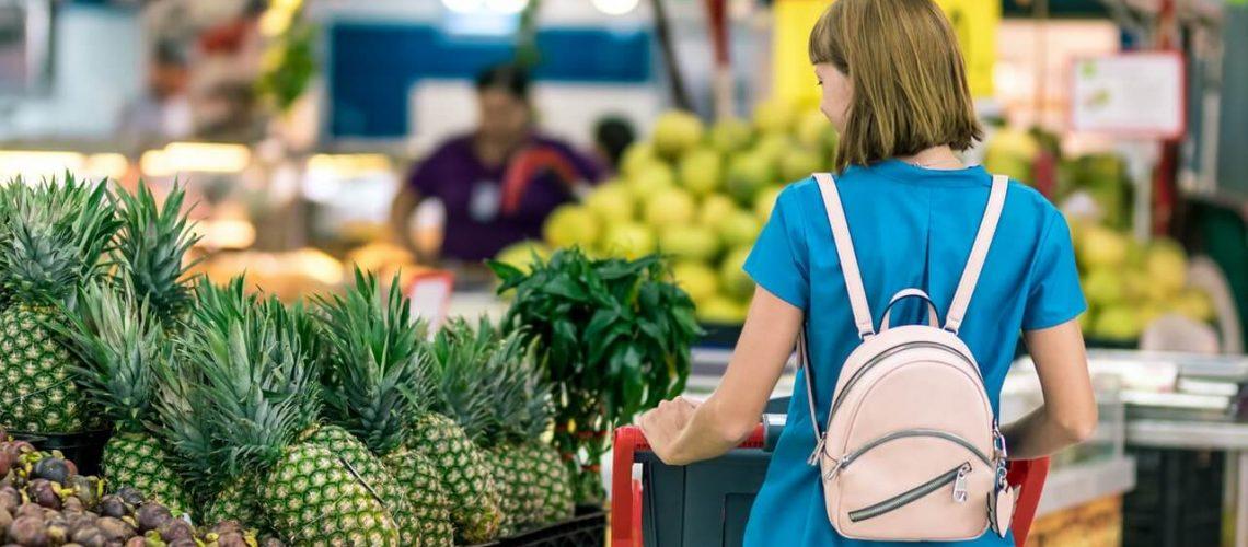 woman-standing-beside-pineapple-fruits-2292919(1)